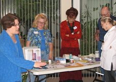 Gayle Goddard (left) shows workshops participants how to sort a desk.