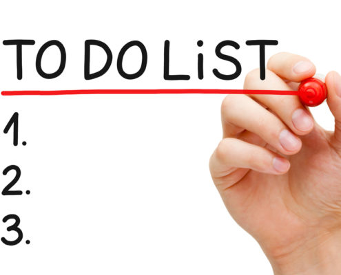 """Hand underlining """"To-do list"""" with red marker"""