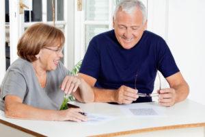 Senior citizens working on paperwork