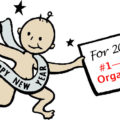 New Year's baby holding sign