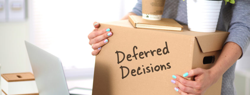 "Cardboard moving box labeled ""Deferred Decisions"""
