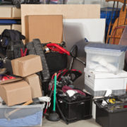 Pile of junk inside a garage.