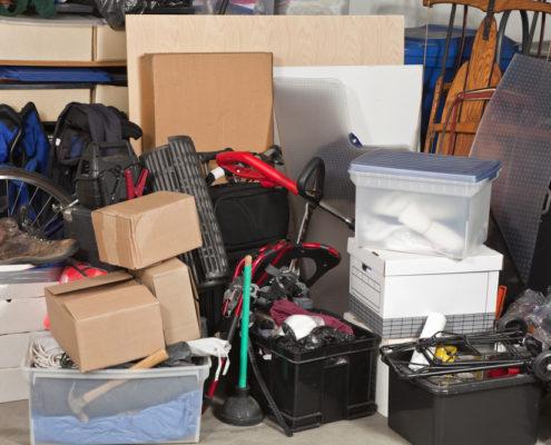 Pile of junk inside a garage.