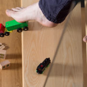 Foot tripping over child's toy on stairs