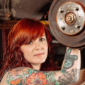 Redheaded tattooed woman mechanic
