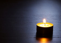 Single tranquil votive candle